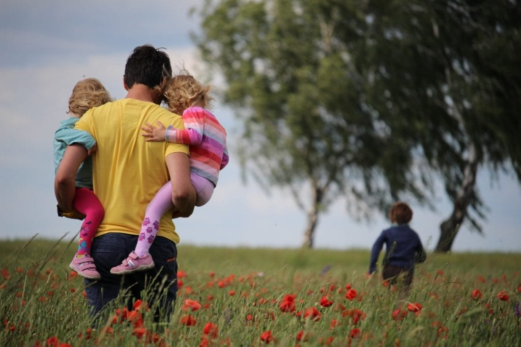 dad and children exploring outside