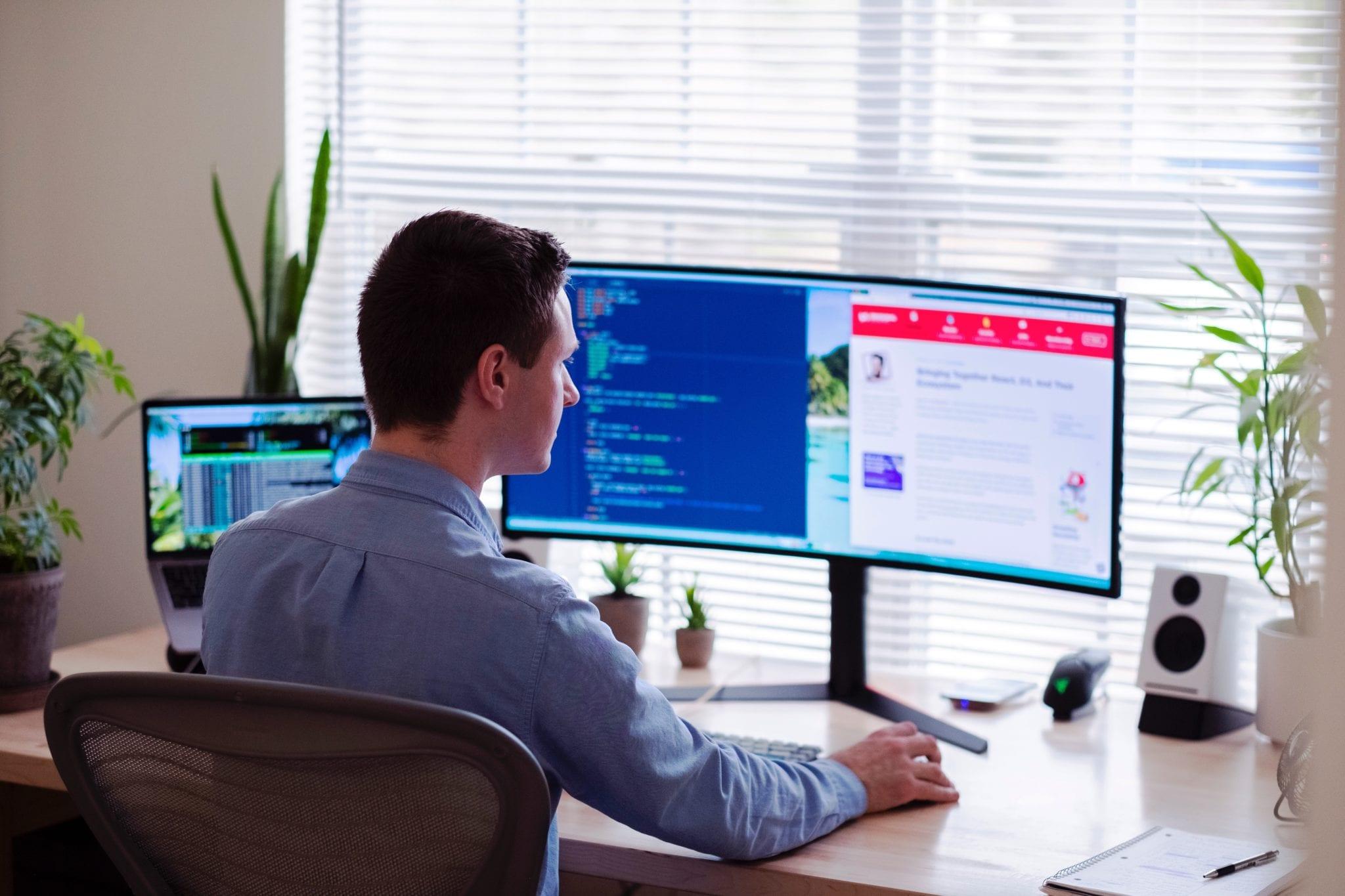 Fleet manager working on construction fleet management on the computer